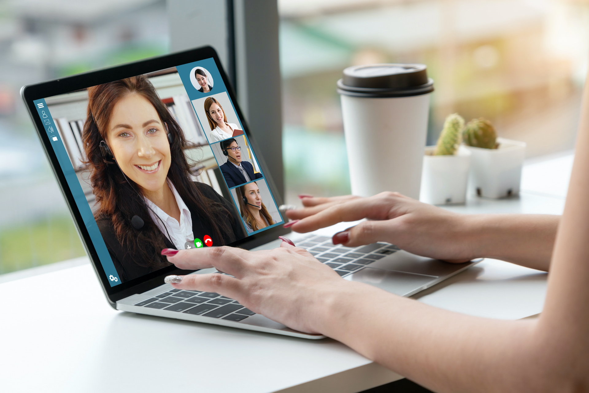 Woman jobseeker doing a virtual job interview with hiring managers on laptop