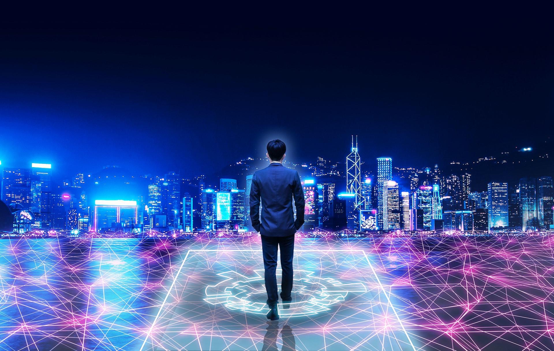 Man standing before Hong Kong skyline