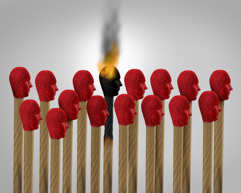 Red matchsticks and one on fire symbolising employee burnout while working from home