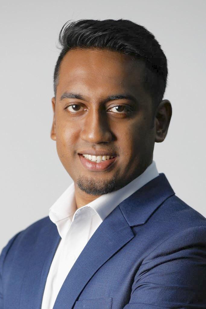 Head shot of South Asian man in a blue blazer and white shirt (Santoz Kumar of IRONMAN Asia)