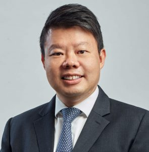 Asian Chief Technology Officer in a dark grey suit