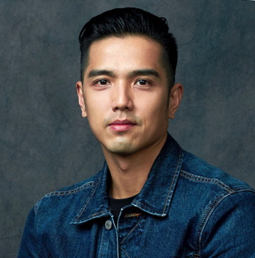 Head shot of Asian man in denim jacket