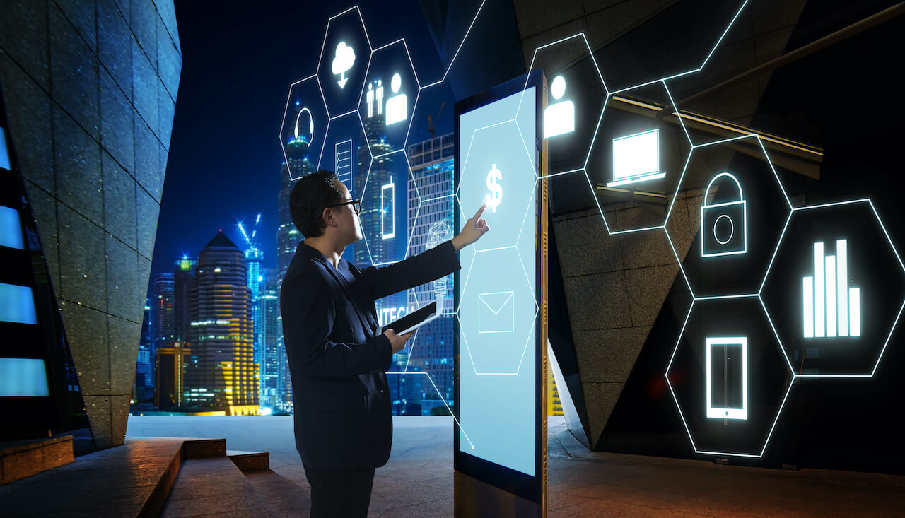 "Man in dark suit touching ""Money"" sign on screen of digital booth with FinTech infographic icon"