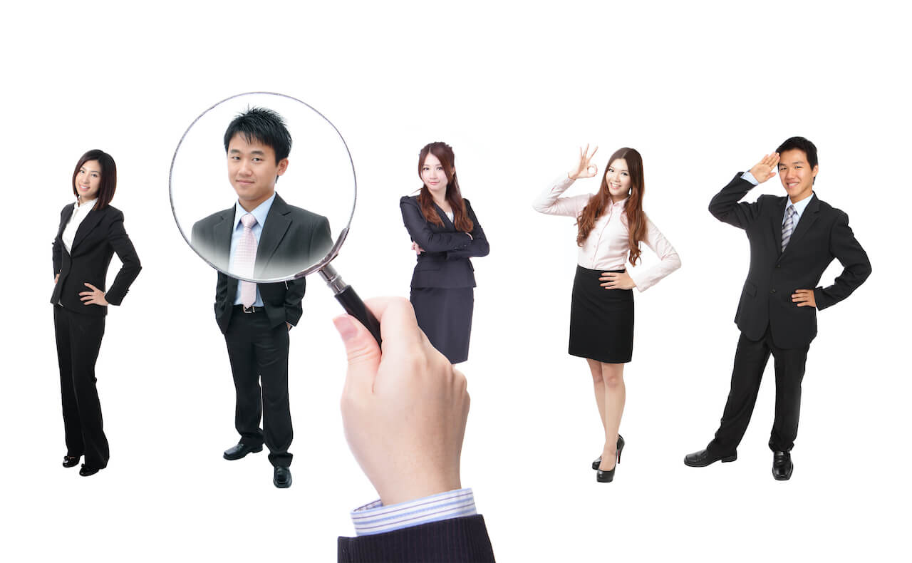 Asian men and women job seekers in business suits